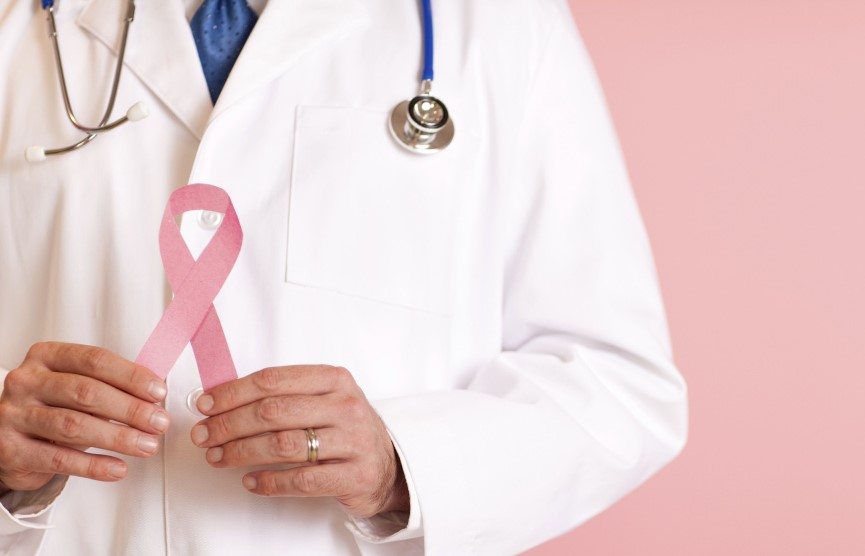Male Doctor Holding Pink Breast Cancer Awareness Ribbon