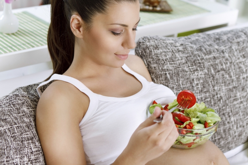 Beautiful pregnancy eating salad